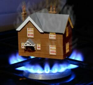plastic house sitting on top of a gas stove burner